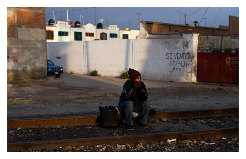Reynosa, Tamaulipas. 23 October 2012. A woman waits for the train by the tracks. The train will get her to the Mexican border with the United States. Around here there are no big groups of immigrants, the only ones left are those who managed to survive all the way from the southern border.